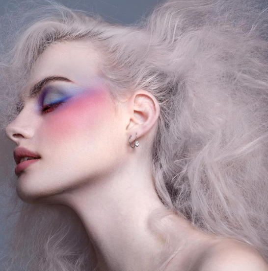 model with purple and pink eye makeup
